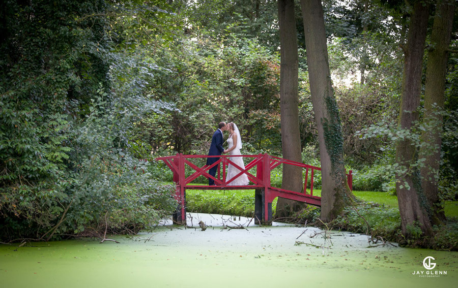 bride and groom in wedding venue grounds